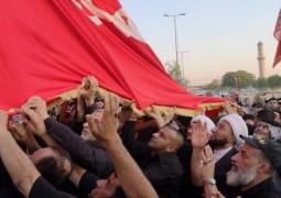 رفع راية ابي الفضل العباس (ع) في سماء بغداد الكرخ