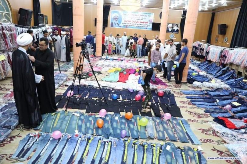 مكتب المرجع اليعقوبي في البصرة يوزع ثلاثة آلاف قطعة لكسوة الايتام والفقراء